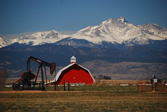 Energy, Farm, and Meeker (Let Ideas Compete) Tags: barn meeker mt mountain grasshopper oil well pump pumpjack jackpump colorado co noddingdonkey horsehead thirstybird srp mountainside awesome farm field snow shadow shadows rockymountains ridge ridgeline prairie plains beautiful postcard contrast contrasts perspective amazing slope slopes terrain landscape red geology scale energy resources natural roof rooftop gambrel concordians fun gambrelroof essence shannonredbarnfarm