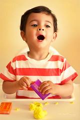 Plastilinas (Malia Len ) Tags: portrait orange colors yellow canon 50mm kid purple retrato dani colores lila amarillo malia nio naranja plastilina plastilinas malialeon