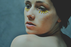 pollen covered [Explore Front Page] (laura zalenga) Tags: light woman flower girl face yellow wall closeup grey eyes lashes skin makeup tulip pollen shoulder gaze glassroof laurazalenga