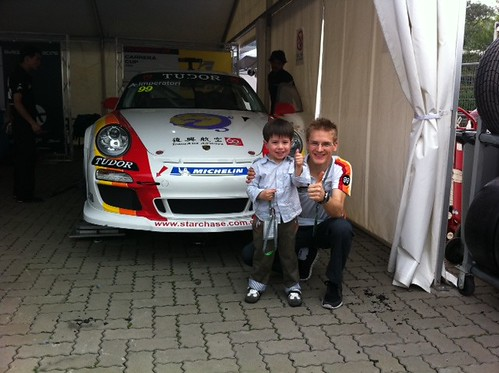 Scott with Alexandre Imperator and his car in the Porsche Carrera Cup Asia area