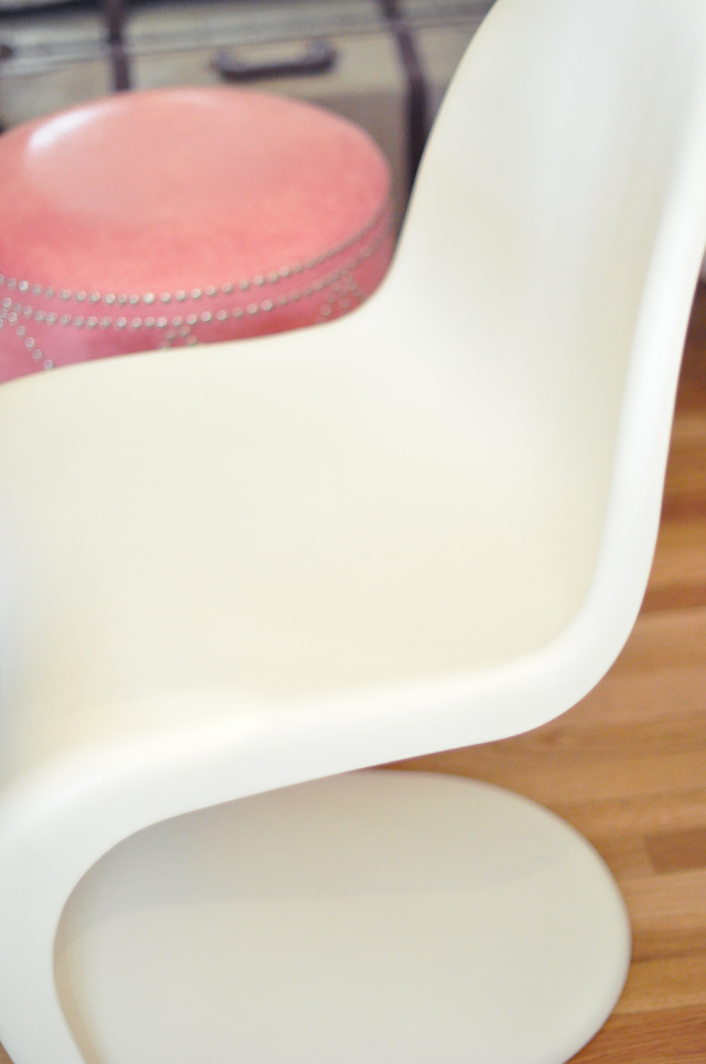 white panton chair + pink crocodile ottoman and vintage suitcase