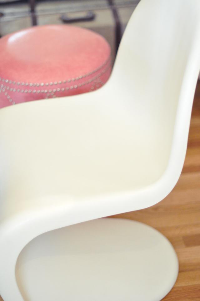 white panton chair + pink crocodile ottoman and vintage suitcase