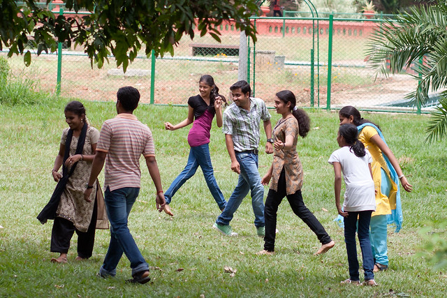 Young people playing in Lal Bagh Botanical Garden