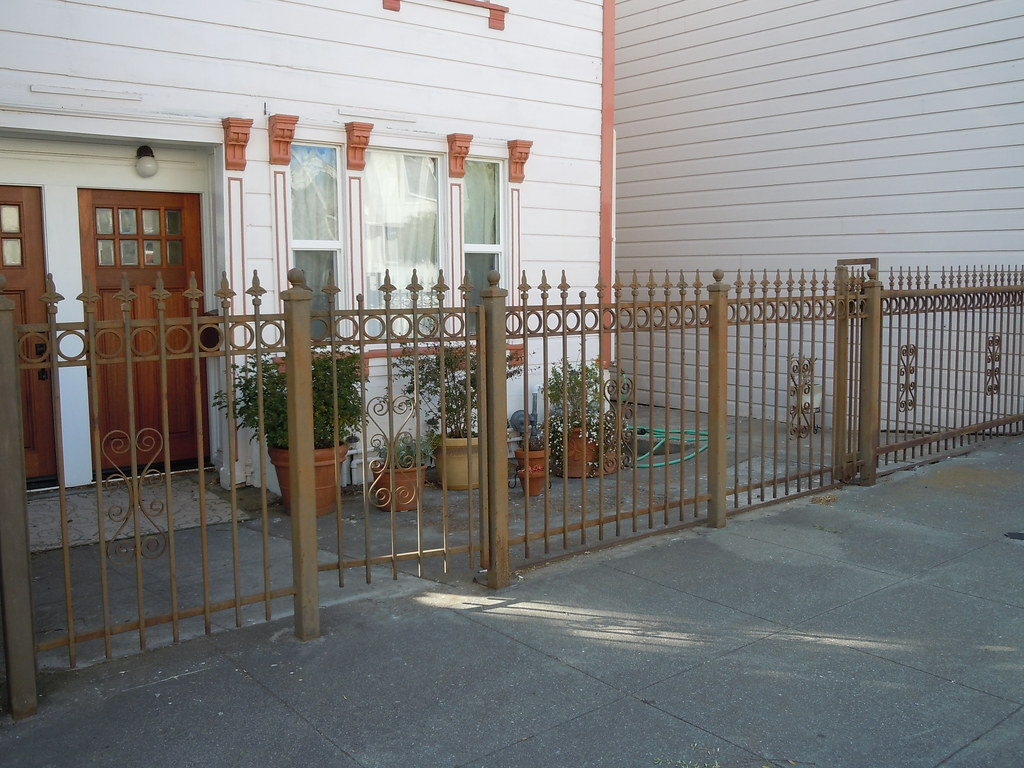 flat front Italianate house with rare cast iron fence