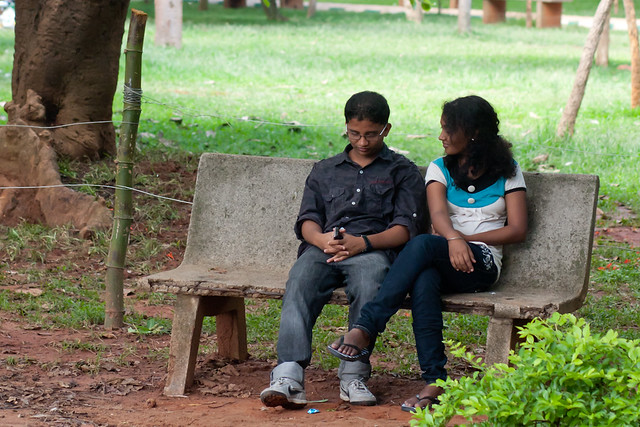 Couple on a bench in Cubbon Park in Bangalore