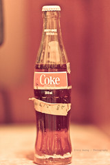 A bottle of Coke - June 85' (Ernie Kwong Photography (IG @itskwongertime)) Tags: lighting old colour vintage bokeh objects 1985 oldsoda canonef50mmf12usm bottledcoke