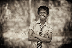 Bokehlicious smile. (whoisnd) Tags: school trees light portrait bw smile shirt forest canon pose hair kid eyes hands bokeh teeth beautifullight posing tie casual pure tones vignette 70200 f28 diffused scars bunk flunk diffusedlight beautifulsmile 1d4 1div puresmile