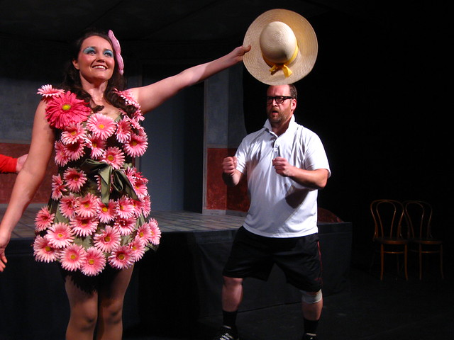 Savannah tries to learn to hold her hat like a champion from Don and Percy (Bryan Krasner), the Pageant Masters.