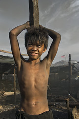 Ulingan, Tondo - Portrait of a charcoal boy (Mio Cade) Tags: boy portrait kid factory child smoke philippines dirt charcoal manila dust tondo ulingan