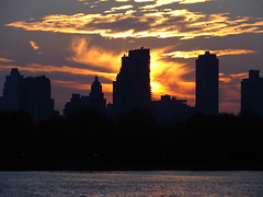 Sunset (Diego3336) Tags: park nyc newyorkcity winter light sunset sky urban usa cloud lake ny newyork reflection building nature water silhouette skyline clouds america skyscraper buildings reflections twilight lowlight cityscape skyscrapers nightshot dusk centralpark manhattan reservoir centralparkreservoir jacquelinekennedyonassisreservoir