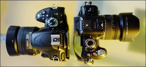 Nikon D5100 35mm f/1.8 Panasonic GH2 7-14mm