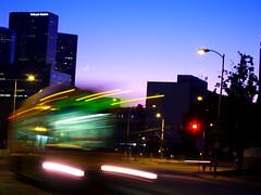 L.A. Ghost Bus 1 (tobysx70) Tags: california ca street toby moon motion blur building bus digital skyscraper canon temple la los twilight downtown angeles dusk ghost wells powershot crescent highrise hancock fargo s90 canonpowershots90 canons90 tobyhancock