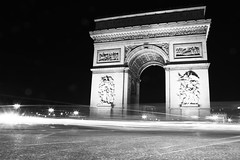 L'Arc de Triomphe #2 (batmanday97) Tags: street bw white black paris france cars car canon de eos rebel grey blackwhite stream arch gray arc triomphe headlights du triumph arcdetriomphe archoftriumph streamline larc larcdetriomphe larcdutriomphe baclandwhite t1i canonrebelt1i
