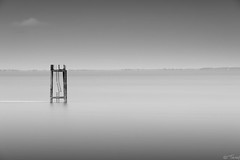 Stranded (tricky (rick harrison)) Tags: ocean uk longexposure sea blackandwhite broken stairs coast unitedkingdom decay yorkshire platform northsea mooring ladder hull ladders humber eastyorkshire spurn spurnpoint humberside spurnhead yorkshirecoast nd10 seablur