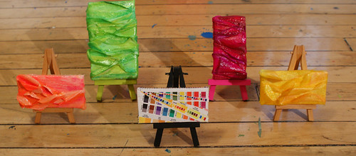 mini paintings and collages on easels