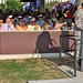 The royal court and Mrs. Sarah Lynch listen as LTG Swan's remarks during the military ceremony