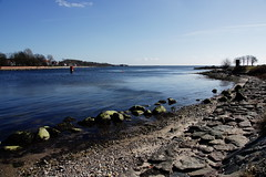 Sunny days are yet to come (**Alice**) Tags: blue sea sky water denmark sand rocks mare stones pietre shore apa nisip cer sonderborg albastru tarm sometrees 16105mm sony450 cevacopaci