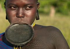 Surma woman with lip plate and scarifications - Omo Ethiopia (Eric Lafforgue) Tags: africa people woman colour face horizontal female outdoors person plateau portait headshot clay omovalley ethiopia tribe surma personne humanbeing scars argile scarification bodymodification tete visage labret contemplation tribu omo eastafrica suri abyssinia 833 exterieur lookingatcamera traditionalclothes piercedlip cicatrices abyssinie vueexterieure coloredpicture lipplug lipplate photocouleur stretchedlip afriquedelest surmatribe etrehumain habittraditionnel tulgit suripeople valleedelomo peuplenomade regardantlobjectif lipdisc plateaulabial turgit peoplesoftheomovalley piercedhole piercedlipornament surmapeople peuplesdelavalleedelomo villageofturgit villagedeturgit tribudessuri suritribe tribudessurma peuplesuri peuplesurma colouredpicture levreetiree levrepercee ornementdelevrepercee femmeaplateau