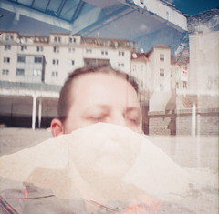 Vanishing. Selfportrait. Has Been Remise Breitensee - Changes 09. April 2011 (hedbavny) Tags: urban selfportrait abandoned self 35mm ego bench lomo lomography doubleexposure decay grain autoretrato demolition couch stadt change analogue noise derelict selbstportrait korn forlorn vernderung remise verfall abris doppelbelichtung filmanalog breitensee dianamini