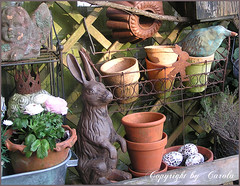 In my garden shelf (Boxwoodcottage) Tags: bunny bird cake angel garden spring iron hare mosaic rusty ranunculus pots clay eggs april shelves 2011 criwn muld boxwoodcottage
