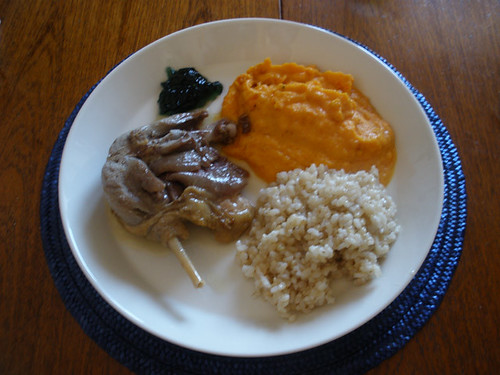 Duck leg with rice and sweet potato & carrot dish