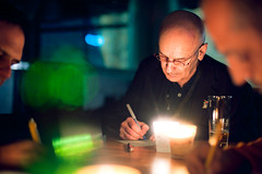 Messages (TGKW) Tags: old portrait people man men green beer glass night pen writing paper table bottle sitting candle stockholm bokeh bald meeting elderly conference candlelight nightlife cabaret messages foreground ietm 5113