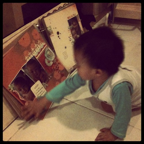 I'm so touched! He is browsing my scrapbook :)