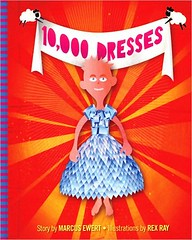 Cover of 10,000 Dresses shows has a banner across the top of the book with the title of the book on it. The illustration shows Bailey, the story's main character, standing in a dress made of diamonds in front of a bright orange background.