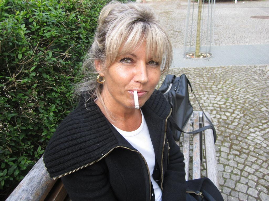 Mature woman smoking cigarette