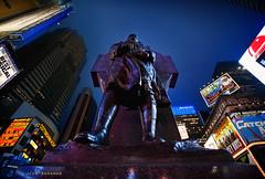 Duffy Square (Jeff_B.) Tags: city nyc newyorkcity newyork statue night neon glow cityscape manhattan timessquare duffysquare fatherduffy fighting69th tourisem francisduffy