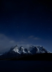 Cuernos del Paine on a semi-clear night (malaholic) Tags: chile patagonia mountain clouds stars nightsky torresdelpaine cuernos torresdelpainenationalpark cuernosdelpaine cuernosdelpaineatnight