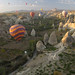 Hot air balloons fly over Goreme, Cappadocia, Turkey