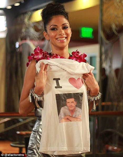 Ego alert! Simon Cowell gives Nicole Scherzinger a cake with his face on it for her birthday  1