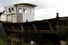 Rust Bucket (Simon in Southend) Tags: door old blur lensbaby marina boat wooden focus marine sweet creative rusty frame desaturated hull rotten leigh 35 essex lensbabies planks leighonsea composer selective optic sweet35