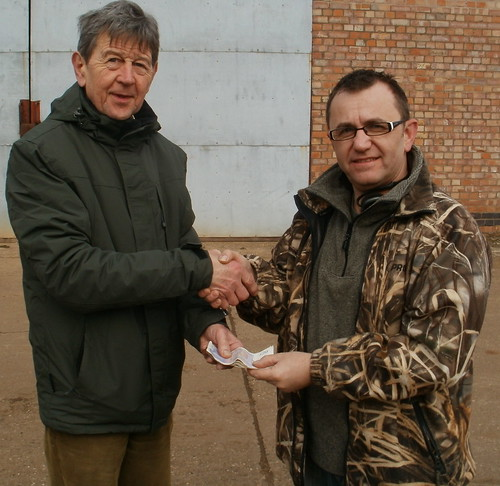 Mark Pickles, Hinckley Search Society committee member, hands over £280 to Don Simpson