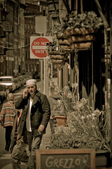Post-Lunch (FarCorner) Tags: street people italy plant man sign boston mobile ma restaurant store nikon phone little cigarette smoke north gang cell trouble jacket end nikkor d300 18200mm pandana