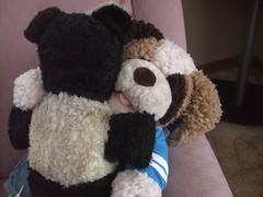 Henry John gives Dad's old teddy a hug