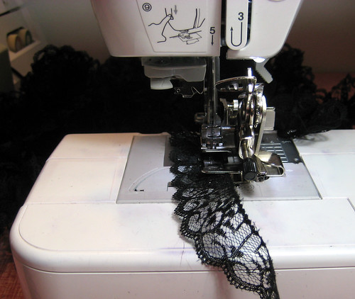 ruffling black lace