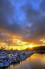 Harbor Sunset (Eddie Yerkish) Tags: ocean blue sunset sky orange reflection water yellow clouds landscape harbor boat danapoint doublyniceshot tripleniceshot mygearandme mygearandmepremium mygearandmebronze mygearandmesilver mygearandmegold mygearandmeplatinum dblringexcellence
