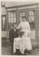 In front of the house (DameBoudicca) Tags: old portrait house man standing vintage table couple