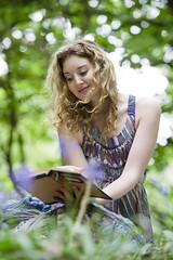 [Ella Rose 1|5]:  A Book of Verses (kinetic lensman) Tags: wood woman flower tree girl forest reading book poetry poem bokeh literature blonde bluebell verses omarkhayym d3s rubiyt theincomparableellarose wineandbreadnotincluded