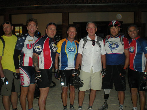 President Bush poses with a few warriors before the start of day 2