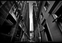 In The Middle of It All... (darth_bayne) Tags: longexposure philadelphia photoshop blackwhite alley centercity canon350d tones sigma1020mm thephoenix comcastbuilding nd400x vertorama darthbayne