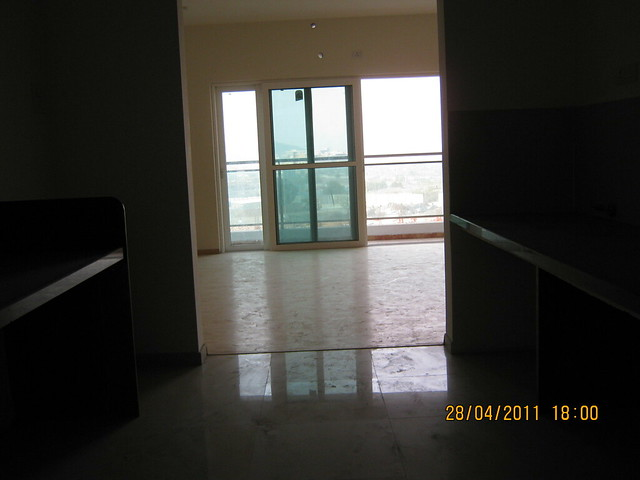 Living and Balcony - view from the kitchen in Sangria Towers at Megapolis Hinjewadi Phase 3, Pune