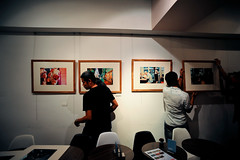 Hanging My First Show (Jon Siegel) Tags: show charity photo cafe nikon singapore shots exhibition ann opening benefit 20mm nikkor f28 siang singaporean annsianghill d700 shotscafe