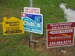 houses for sale sign