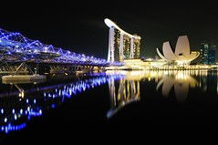 Marina Bay Sands Hotel, in bulb (badzmanaois) Tags: city bridge light sky urban reflection building tower skyline architecture modern night skyscraper marina river landscape hotel evening bay harbor twilight singapore asia downtown cityscape waterfront riverside dusk district famous central landmark center casino structure illuminated resort business commercial metropolis helix sands promontory gettyimagessingaporeq2