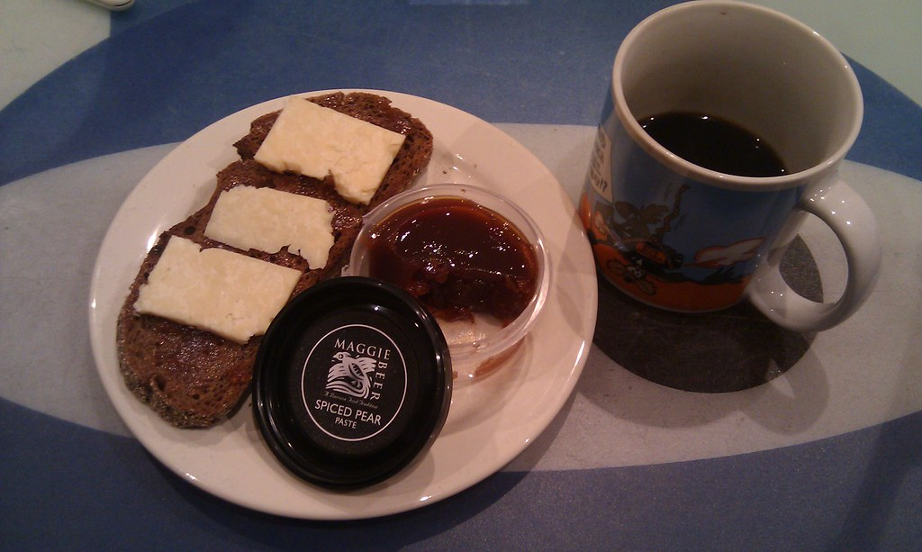 Parmesan and spiced pear paste on multi grain rye, Bali coffee