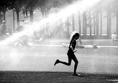run... (wojofoto) Tags: amsterdam museumplein girl running stadsarchief wojofoto nederland netherland holland wolfgangjosten zwartwit monochrome blackandwhite straatfoto streetphoto people mensen