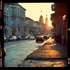 Sunset street (Denis Allbertovich) Tags: street light sunset sky sun color colour cars 120 6x6 film beauty mediumformat square evening photo mood dof kodak bokeh lviv epson 160vc kiev88 v700 lemberg lwow leopolis kaleinar